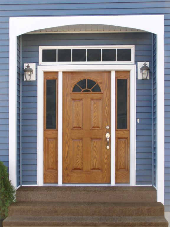 Stained Woodgrain Fiberglass Sunburst Door