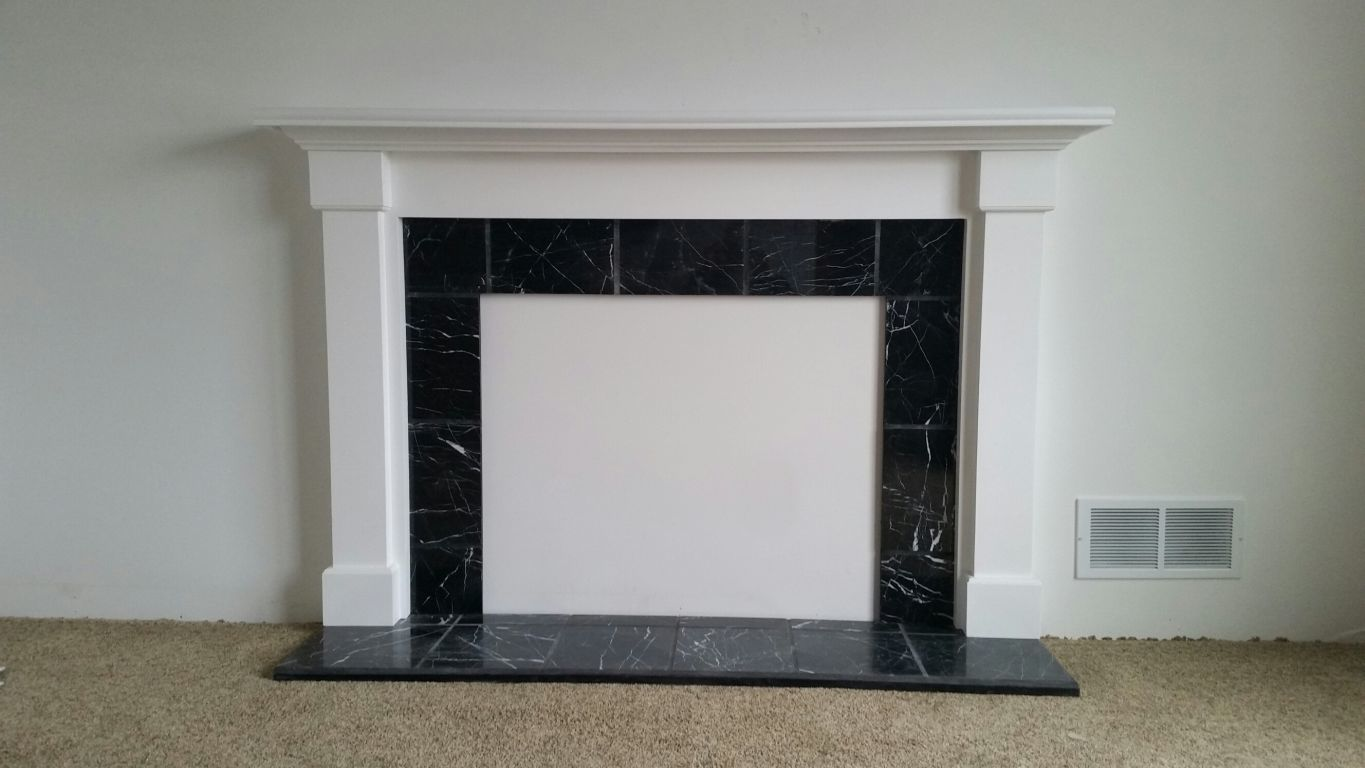 White Fireplace With Black Marble Insert Modular Homes By