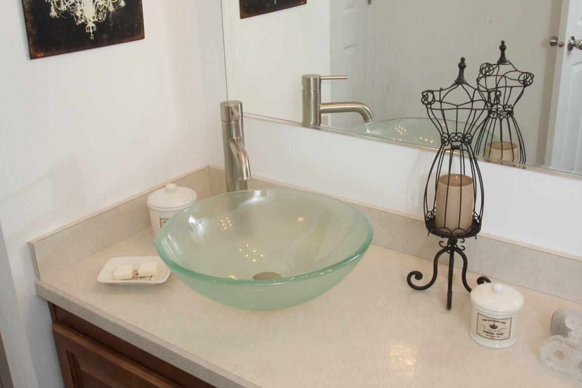 Vessel sink with vessel sink faucet r anell homes for Master bathroom vessel sink